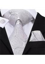 Луксозен комплект за младоженец - вратовръзка кърпичка и ръкавели с флорални мотиви в сребристо сиво